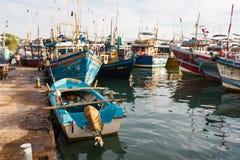 Fish market in Sri Lanka. Tangalle, Sri Lanka - January 31, 2017: Fishing boats in harbor brought a new catch Royalty Free Stock Photo
