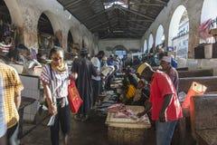 Fish market in Stone Town. Sellers offer fresh fish and seafood in the city market Stone Town on Zanzibar, Tanzania. Africa Royalty Free Stock Photo
