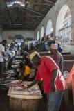 Fish market in Stone Town. Sellers offer fresh fish and seafood in the city market Stone Town on Zanzibar, Tanzania. Africa Royalty Free Stock Photos