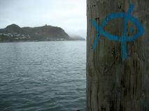 Fish Markings. Fish symbol painted on a pole in a harbour stock images