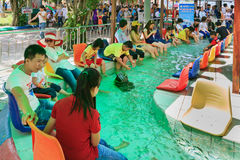 Fish massage in amusement park Suoi Tien Ho Chi Minh stock photo