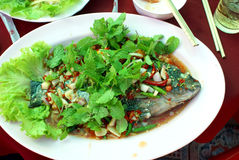 Fish meal. Serve of cooked fish with Asian chilly sauce Stock Photography