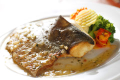 Fish meal. Fish dish with sauce on the plate Stock Photo
