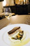 Fish meal at fancy restaurant 2. Fish meal at fancy restaurant with glass of white wine Stock Photo