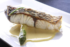 Fish meal, perch with butter. Perch with butter and asparagus on the dish Royalty Free Stock Image