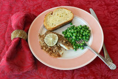 Fish Meal on a pink plate with napkin Stock Images