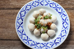 Fish meat ball in plate on wood Stock Images