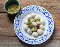 Fish meat ball in plate on wood Stock Photo