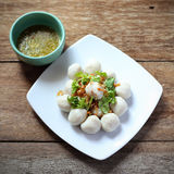 Fish meat ball in plate on wood Royalty Free Stock Photos