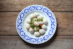 Fish meat ball in plate on wood Stock Photography