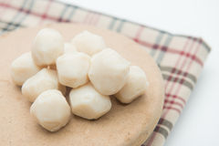 Fish meat balls on wood pad Stock Photography
