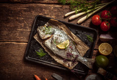 Fish Meat On A Tray With Herbs And Spices Stock Images