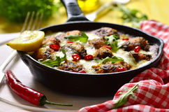 Fish meatball baked in frying pan. Royalty Free Stock Photo
