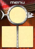 Fish Menu with Metal Porthole. Restaurant fish menu with metal porthole and blue empty pages on wooden background with red checked tablecloth and ropes Stock Image