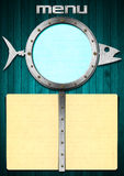 Fish Menu with Metal Porthole. Restaurant fish menu with metal porthole and yellow empty pages Stock Photography