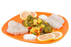 Fish and mixed vegetables on plate Stock Photo