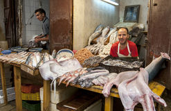 Fish mongers display a variety of seafood for sale in the Fez medina in Morocco. The medina is the oldest walled part of Fez and was originally founded as the royalty free stock images
