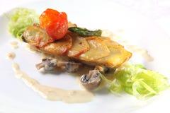 fish with mushroom sauce Stock Photo