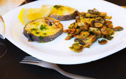 Fish with mushrooms on  plate Royalty Free Stock Photography