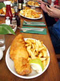 Fish n chips on table Stock Photos