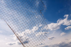 Fish net with blue sky and white clouds Royalty Free Stock Photos