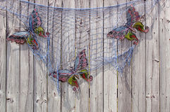 Fish Net and Butterflies on Wooden Fence Royalty Free Stock Photos