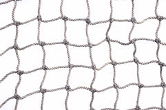 Fish net close up. Old used fishing net with lots of loose hemp fibers left intact. On a white background Stock Photo