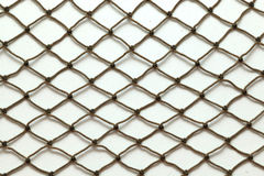 Fish Net. Close up of a fish net against a white background royalty free stock photography