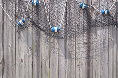 Fish Net with Floats on Wooden Fence Royalty Free Stock Image
