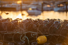 Fish nets and baskets drying on the coast Stock Images