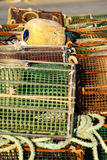 Fish nets and baskets drying on the coast Stock Photography
