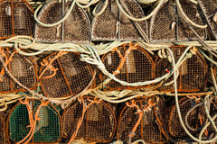 Fish nets and baskets drying on the coast Stock Image
