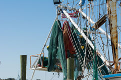 Fish netting hanging on a boat Stock Photos