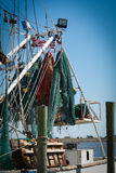 Fish netting hanging from a boat. Royalty Free Stock Photo