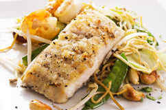 Fish with Noodles and Vegetable Stock Images