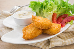 Fish nuggets and dip sauce on plate Royalty Free Stock Photo