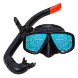 Fish in ocean is reflected in diving mask and snorkel on the beach Stock Images