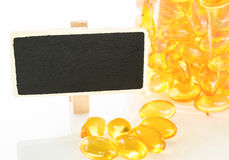 Fish oil and blank wooden tag. Stock Photos