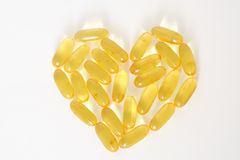 Fish oil capsules. Forming a shape of heart Stock Images