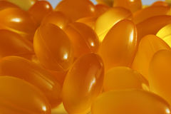Fish oil capsules closeup. Lie next to each other Royalty Free Stock Photo