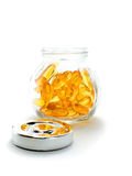Fish oil capsules and container Stock Photos