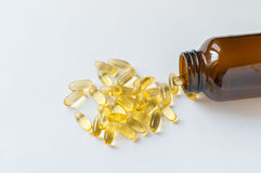 Fish Oil. Capsules and container Royalty Free Stock Photo