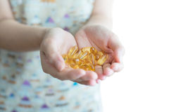 Fish Oil Capsules in Hand Stock Photos