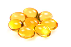 Fish oil capsules macro Royalty Free Stock Images