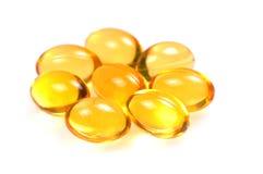 Fish oil capsules macro Royalty Free Stock Images