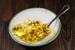 Fish oil capsules Royalty Free Stock Images