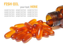 Fish oil capsules pouring out of the bottle isolated on white Stock Images