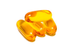 Fish oil capsules  on white Royalty Free Stock Photos