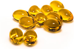 Fish oil capsules on white. Close up shot Royalty Free Stock Photos