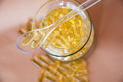 Fish oil in clear spoon Royalty Free Stock Images